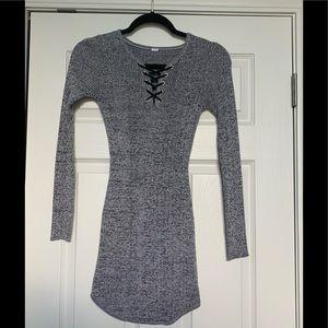 Gray longlseve bodycon mini dress.